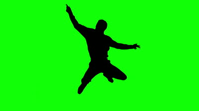 Silhouette of woman listening to music on green screen in slow.