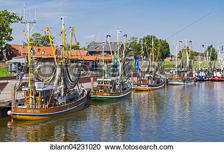 Stock Photography of Shrimp boats in the harbor of Greetsiel, the.