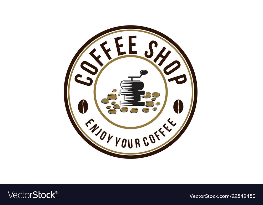 Vintage grinder and pile of coffee bean logo.