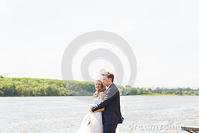 Beautiful Bride And Groom By A Lake Or River Stock Photo.