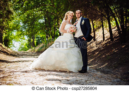 Stock Photography of Bride with Groom at wedding Day walking.
