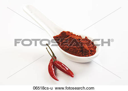 Stock Images of Ground cayenne pepper and red chilli pod 06518cs.