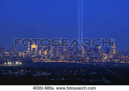 Stock Photography of September eleventh memorial lights at ground.