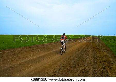 Stock Photography of mountain bike race on ground road in the.