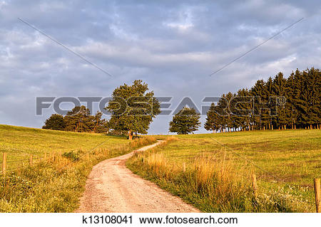 Stock Photography of curved ground road at sunrise k13108041.