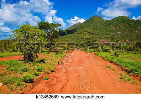 Stock Photograph of Red ground road, bush with savanna. Tsavo West.