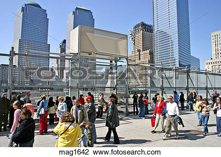 Stock Photo of People walking near Ground Zero site New York City.