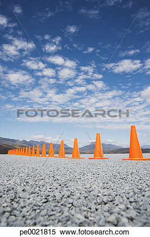 Stock Image of Traffic cones in line outdoors ground level view.