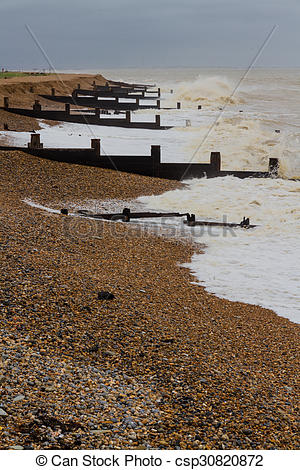 Picture of Stormy English Beach with groynes.