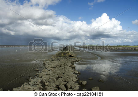 Stock Illustration of Groynes on the beach at the north sea during.