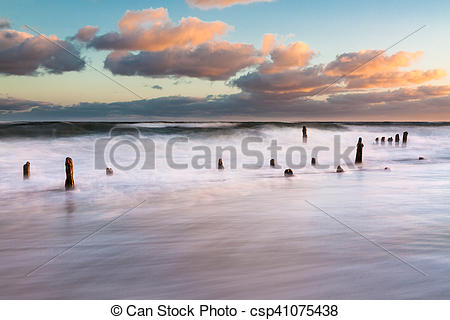 Stock Photos of Groynes on shore of the Baltic Sea on a stormy day.