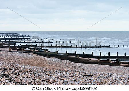 Stock Image of wooden groynes at the beach.