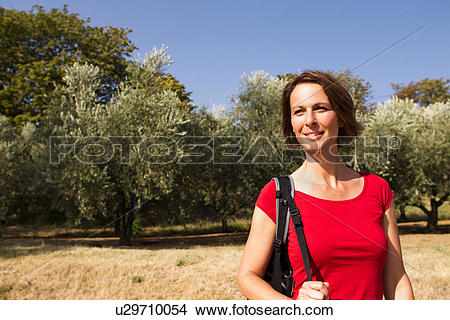 Stock Photo of Woman in olive grove, Groznjan, Istria, Croatia.