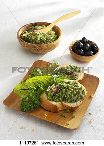 Stock Photography of White bread with pesto made from the herbs.