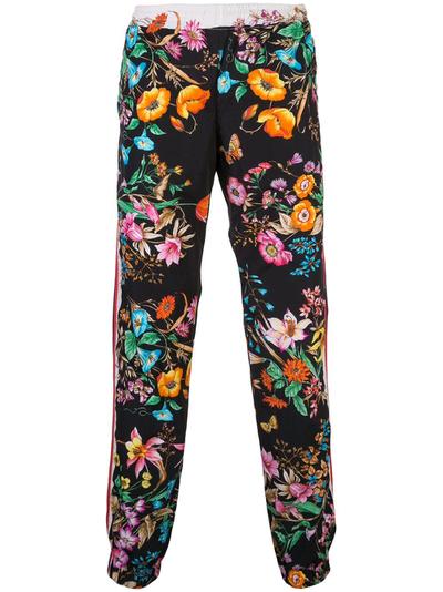 Gucci floral print track pants.