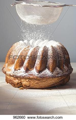 Stock Photography of Sprinkling gugelhupf with icing sugar 962660.