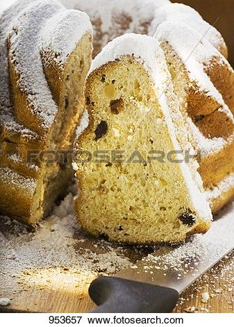 Picture of Gugelhupf with icing sugar, partly sliced 953657.