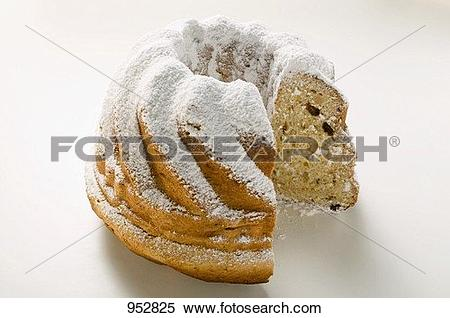 Stock Image of Gugelhupf with icing sugar, a slice taken 952825.