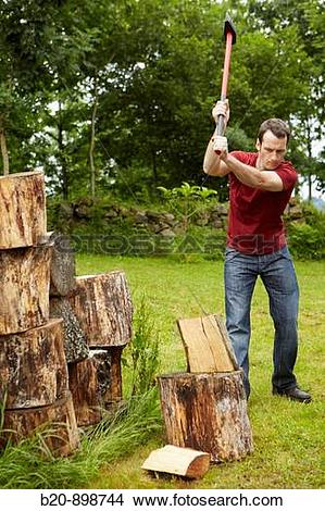 Stock Photo of Cutting wood with splitting axe, hand tool, farming.