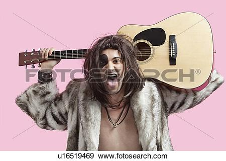 Stock Photograph of Portrait of young male musician with mouth.