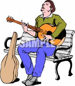 Man Sitting on a Park Bench Playing Guitar.