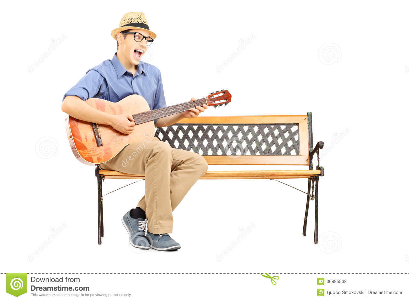 Ecstatic Young Guitarist Sitting On Bench And Singing Royalty Free.