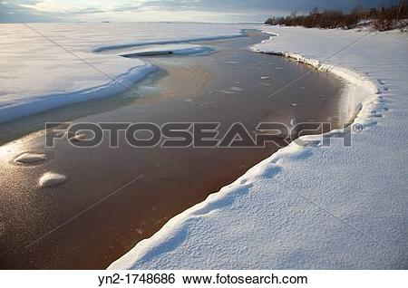 Stock Images of Melting weak spot on sea ice. Location Gulf of.