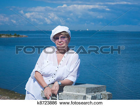 Stock Images of The woman on the background of the Gulf of Finland.