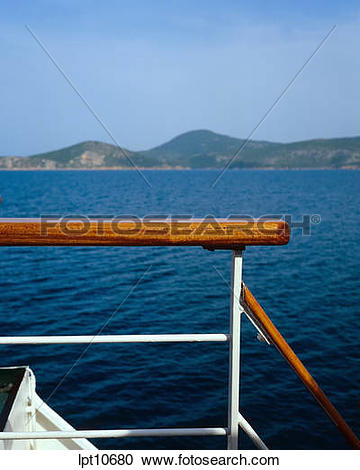 Stock Photography of GUARDRAIL OF A CRUISE SHIP AND COAST SARONIC.