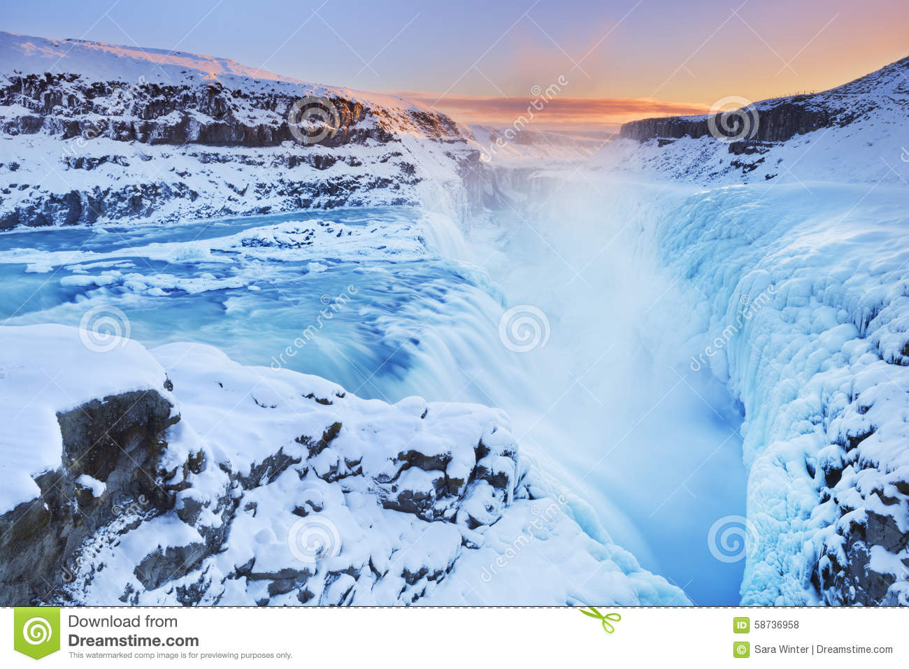 Frozen Gullfoss Falls In Iceland In Winter At Sunset Stock Photo.