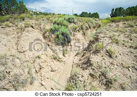 Stock Photography of Desert Wash Arroyo Showing Erosion New Mexico.