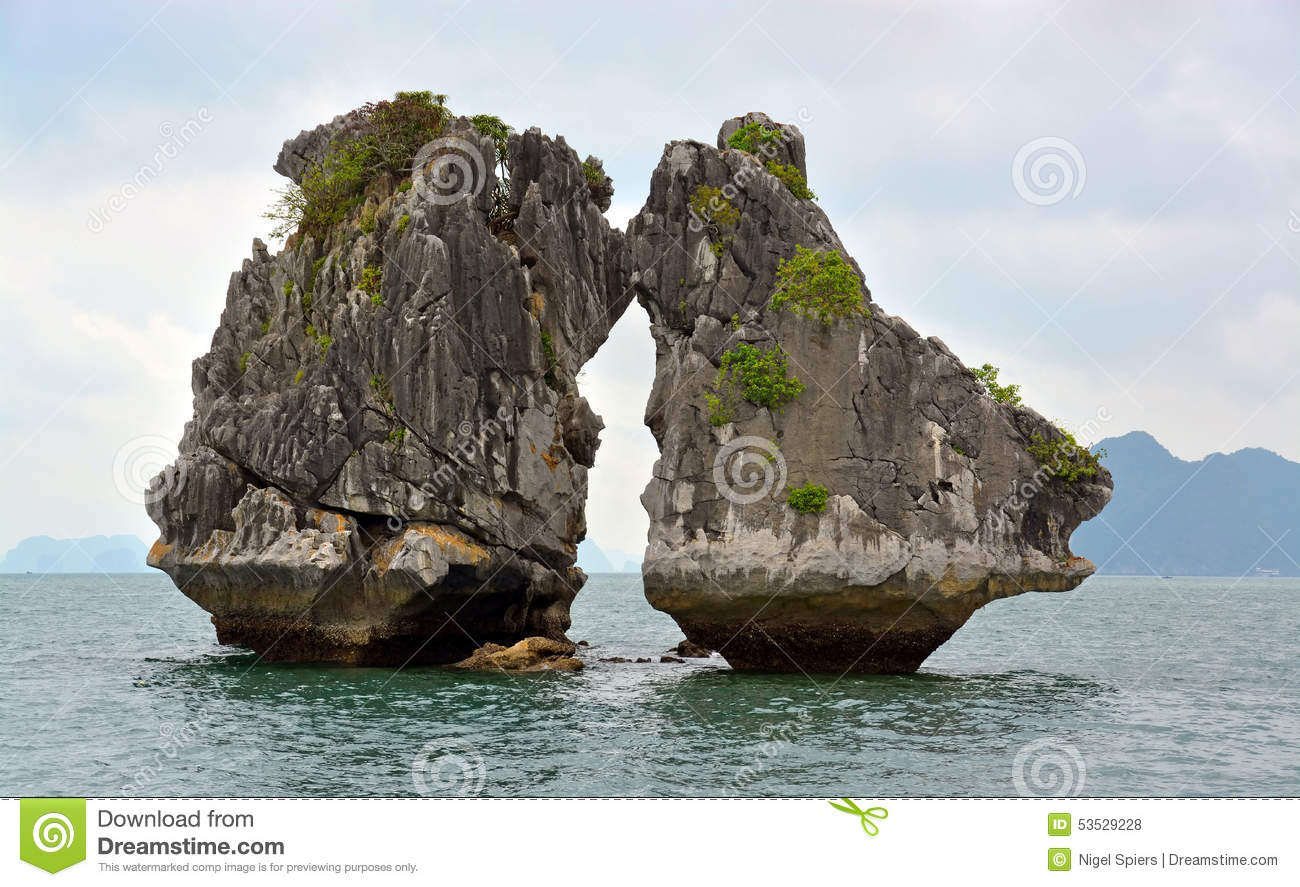 Two Fighting Rocks In Halong Bay Stock Photo.