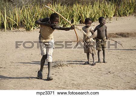 Stock Photography of Hadza children practicing archery, Tanzania.