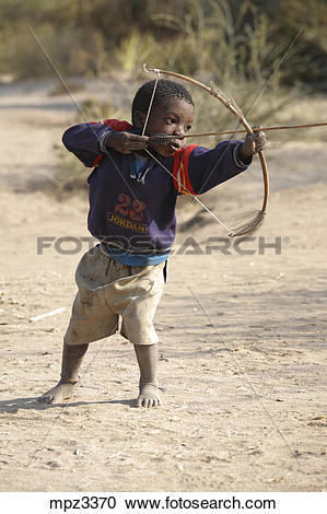Stock Photography of Hadza child practicing archery, Tanzania.