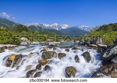 Stock Photo of Matsu river and Hakuba mountain range, Nagano.