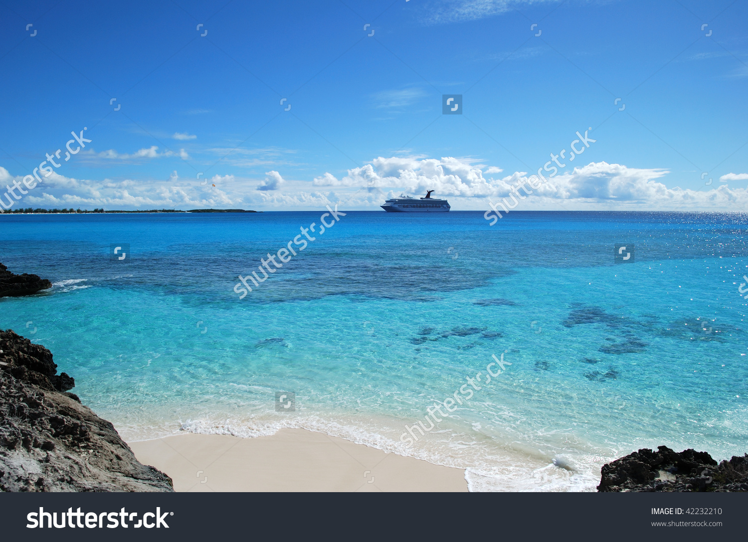 The View Of Half Moon Cay Beach With A Cruise Liner In A.