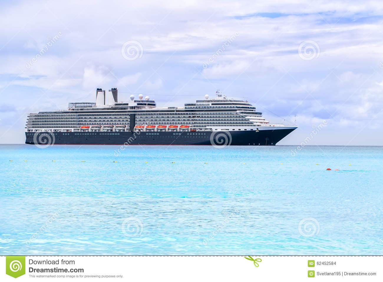 Cruise Ship On A Light Blue Sea At Half Moon Cay In The Bahamas.