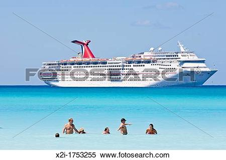 Stock Image of Cruise ship passengers play in water while ship is.