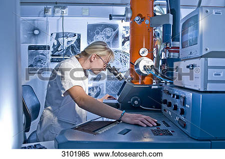 Stock Image of Laboratory technician working on an electron.