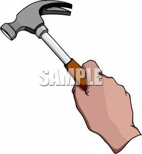 Hand Holding a Hammer.