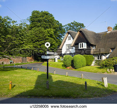 Stock Image of England, Hampshire, Chilbolton. Thatched cottages.