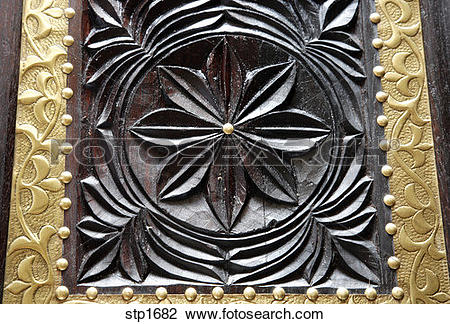 Stock Photo of Zanzibar. Tanzania. Detail of hand carved antique.