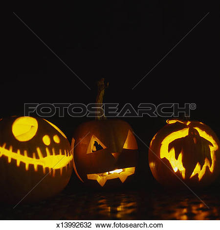 Stock Photo of Illuminated hand carved pumpkins x13992632.