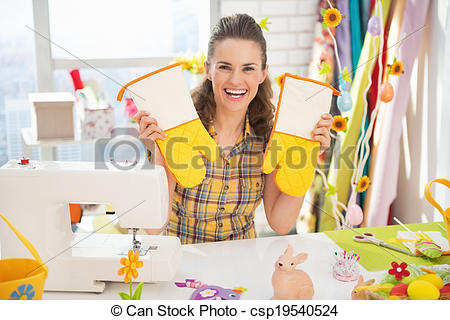 Stock Photo of Happy young woman showing easter hand made pot.