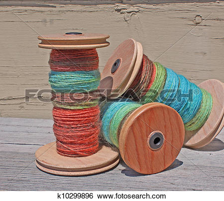 Stock Images of hand spun alpaca wool on a spool k10299896.
