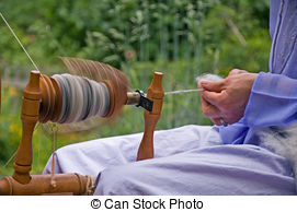 Stock Photographs of hand spun alpaca wool on a spool.