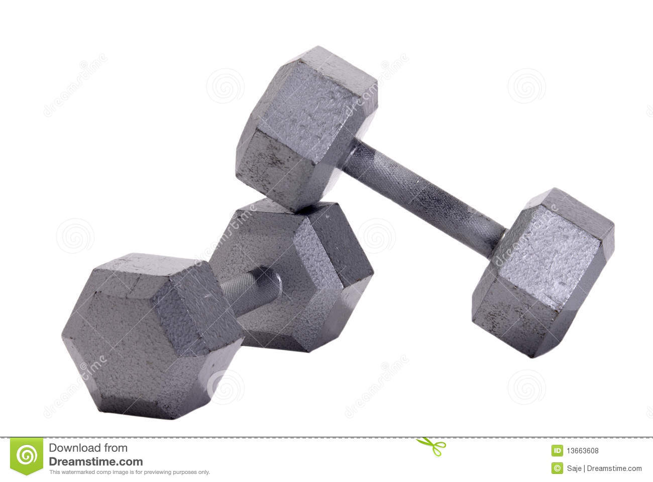Dumbbells And Stacked Weights On A Gym Floor Royalty Free Stock.