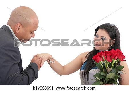 Stock Photography of Man ready to give a kiss in hand to his wife.