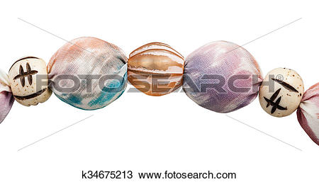 Stock Photo of pink painted silk beads, bone and glass balls.