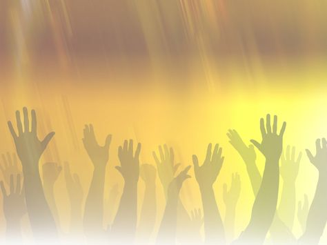 many hands raised to worship God.